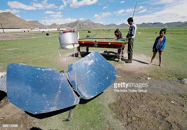 Villagers playing pingpong in a Central Tibet village near Lhatse Food gets cooked in a Solar cooker Pingpong is a Chinese game somewhat similar to...