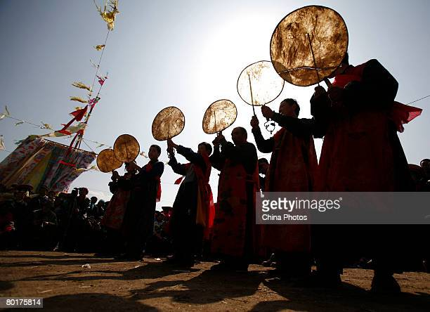 Villagers pray during a ceremony to worship the Erlang God at the Dazhuang Village on March 9 2008 in Huzhu County of Qinghai Province China The...
