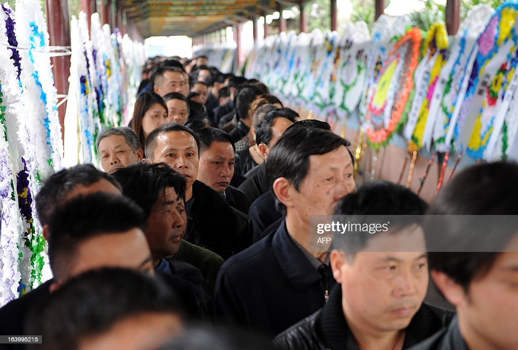 Villagers queue up to pay their respects to Wu Renbao, the former secretary of Huaxi Village Communist Party Committee, at his home in Huaxi Village, east China's Jiangsu Province on March 19, 2013, after the 85-year-old cadre died from lung cancer on March 18. Foungded in 1961, Huaxi Village claims itself to be the richest village in China and calls itself a model socialist village. CHINA OUT AFP PHOTO