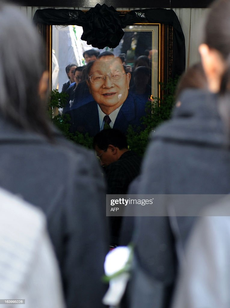 Villagers queue up to pay their respects to Wu Renbao, the former secretary of Huaxi Village Communist Party Committee, at his home in Huaxi Village, east China's Jiangsu Province on March 19, 2013, after the 85-year-old cadre died from lung cancer on March 18. Foungded in 1961, Huaxi Village claims itself to be the richest village in China and calls itself a model socialist village. CHINA