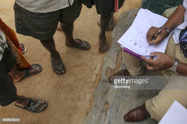Villagers register at a mobile clinic run by the Jain Institute of Vascular Sciences at Pancharala on the outskirts of Bengaluru India on Friday June...