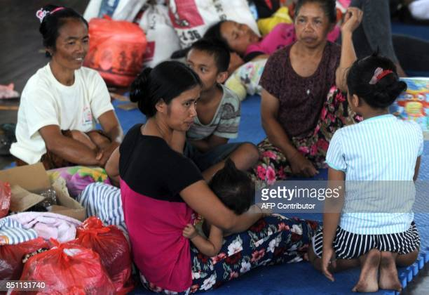 Villagers rest after being evacuated during the raised alert levels for the volcano on Mount Agung in Klungkung regency on the Indonesian resort...
