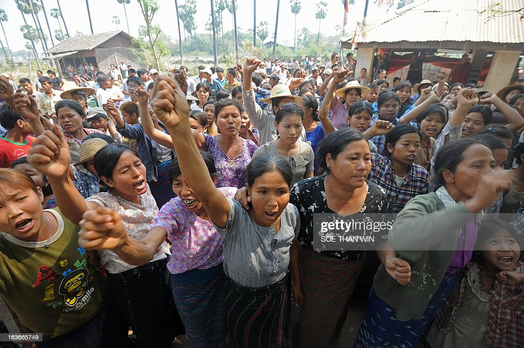 Villagers shout slogans as they protest against Myanmar opposition leader Aung San Suu Kyi's stand on a Chinese-backed copper mine project, in Monywa northern Myanmar on March 14, 2013. Suu Kyi urged protesters to accept a controversial Chinese-backed mine that was the scene of a violent crackdown last year, or risk hurting the economy. AFP PHOTO/ Soe Than WIN