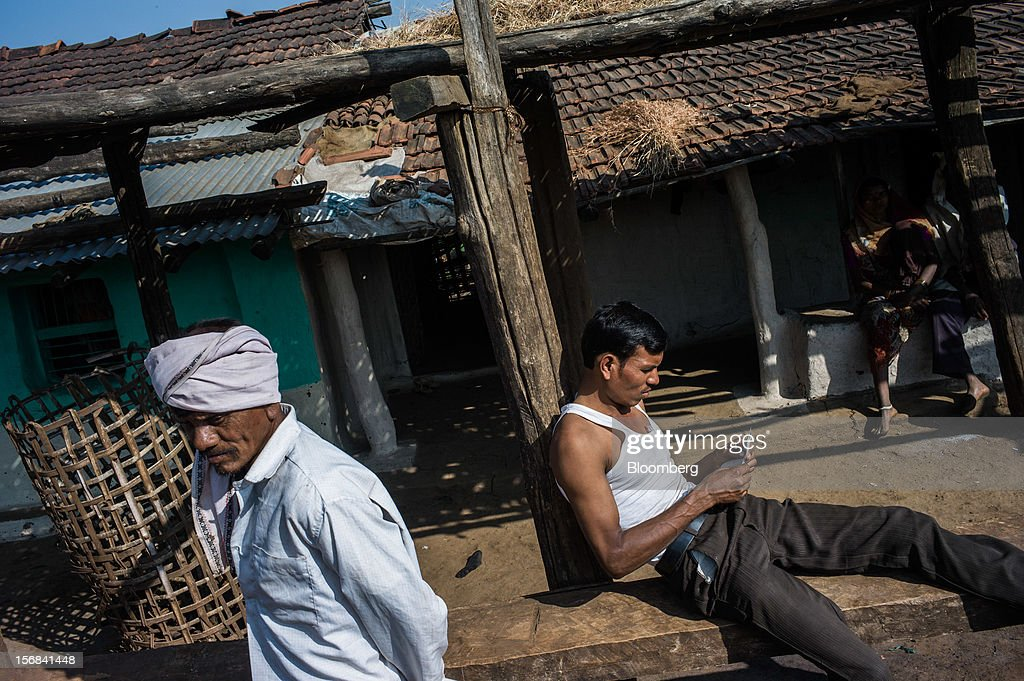 Villagers sit outside their homes in Makhla village, Maharashtra, India, on Thursday, Nov. 15, 2012. The Indian economy will expand 4.9 percent in 2012, the least in a decade, according to the International Monetary Fund. Photographer: Sanjit Das/Bloomberg via Getty Images
