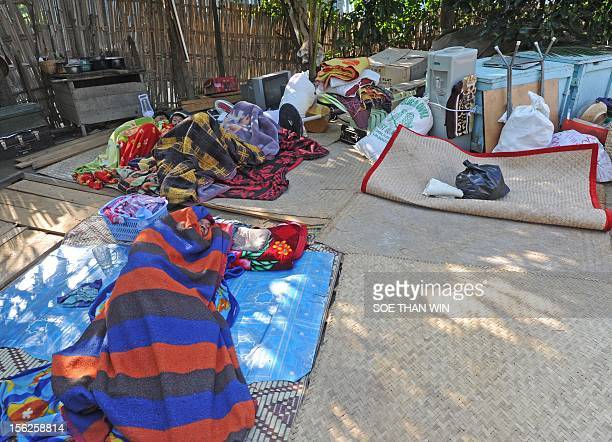 Villagers sleep on the ground in Sintgu township Mandalay a division in central Myanmar on November 12 2012 Rescuers in Myanmar struggled Monday to...