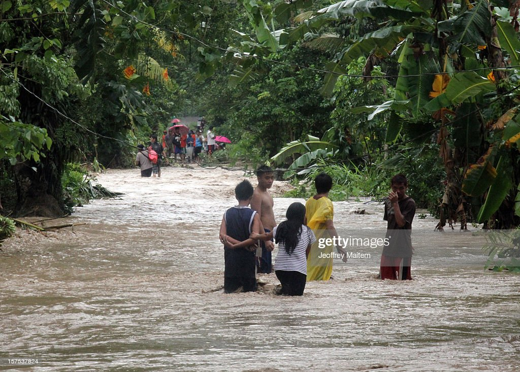 Villagers wade through flood water after heavy rains and strong winds, brought about by Typhoon Bopha, hit the township of Mabini on December 04, 2012 in the province of Compostela Valley in the southern Philippines. Typhoon Bopha made landfall in the southern Philippines earlier today, bringing heavy rain and wind gusts of 210 km/h (130mph). So far at least 40 have died and over 40,000 people have been forced into shelters.