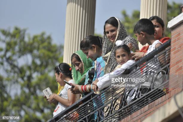 Villagers waiting for Canadian Defence Minister Harjit Singh Sajjan to welcome during his visit on his ancestral village Bombeli on April 20 2017 in...