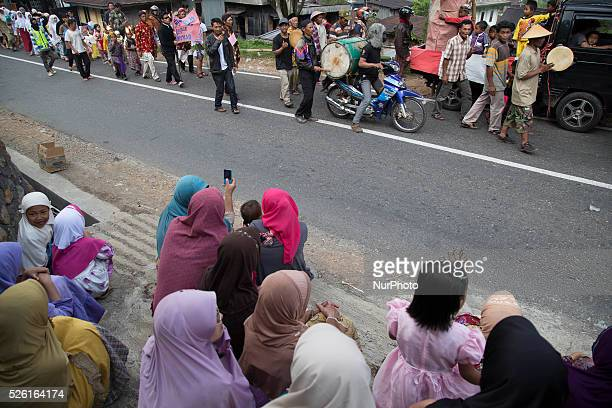 Villagers watching the Karnaval perfromance at Dieng Dieng plateau in Central Java is part of the district of Banjarnegara and Wonosobo regency It...