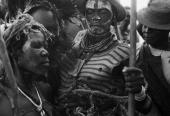 Villagers wearing tribal costume and jewellery dancing in Katcha in the Nuba Mountains of Kordofan East Sudan 28th November 1995