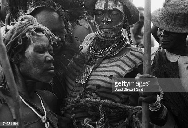 Villagers wearing tribal costume and jewellery dancing in Katcha in the Nuba Mountains of Kordofan East Sudan 28th November 1995