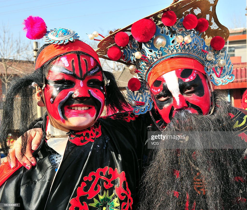 Villagers with Chinese opera costumes pose for photos during a Spring Festival celebration on February 22, 2013 in Xi an, China. The Chinese Lunar New Year of Snake also known as the Spring Festival, which is based on the Lunisolar Chinese calendar, is celebrated from the first day of the first month of the lunar year and ends with Lantern Festival on the Fifteenth day.