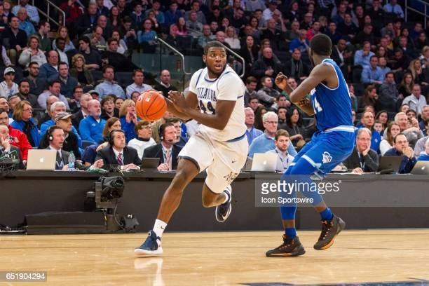 Villanova Forward Eric Paschall works around Seton Hall Forward Ismael Sanogo during the first semifinal matchup in the BigEast Conference men's...
