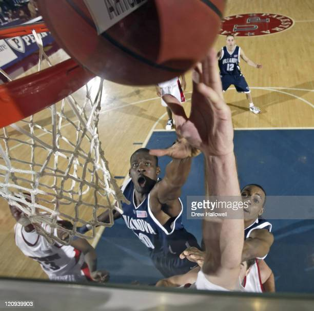 Villanova forward Jason Fraser and Randy Foye go up for a rebound with an unidentified Penn player Tuesday December 13 2005 at The Palestra in...