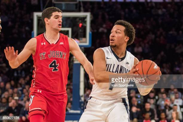 Villanova Guard Jalen Brunson looks to pass the ball around St John Guard Federico Mussini during the quarterfinals of the BigEast Conference...