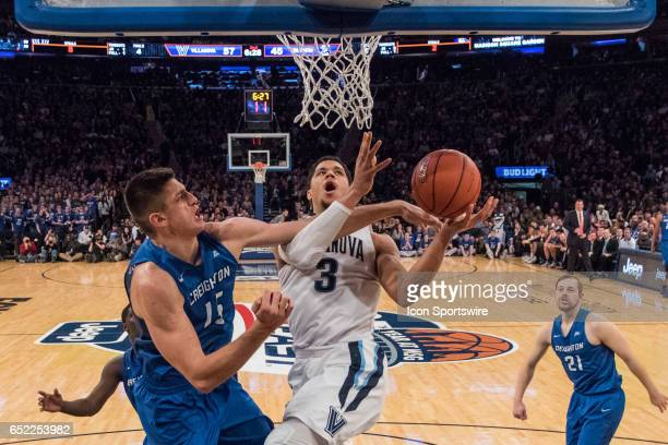 Villanova Guard Josh Hart gets fouled by Creighton Forward Martin Krampelj going to the rim during the championship matchup in the BigEast Conference...