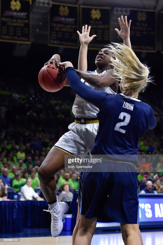 Villanova Wildcats' Alex Louin (2) strips the ball away from Notre Dame Fighting Irish's Jackie Young (5) during the second round of the Division I Women's Championship on March 18, 2018 in South Bend, Indiana.