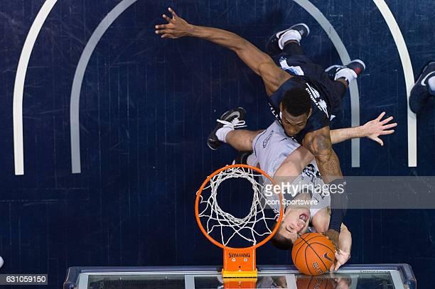 Villanova Wildcats forward Darryl Reynolds blocks a shot by Butler Bulldogs forward Andrew Chrabascz in the lane during the NCAA men's basketball...