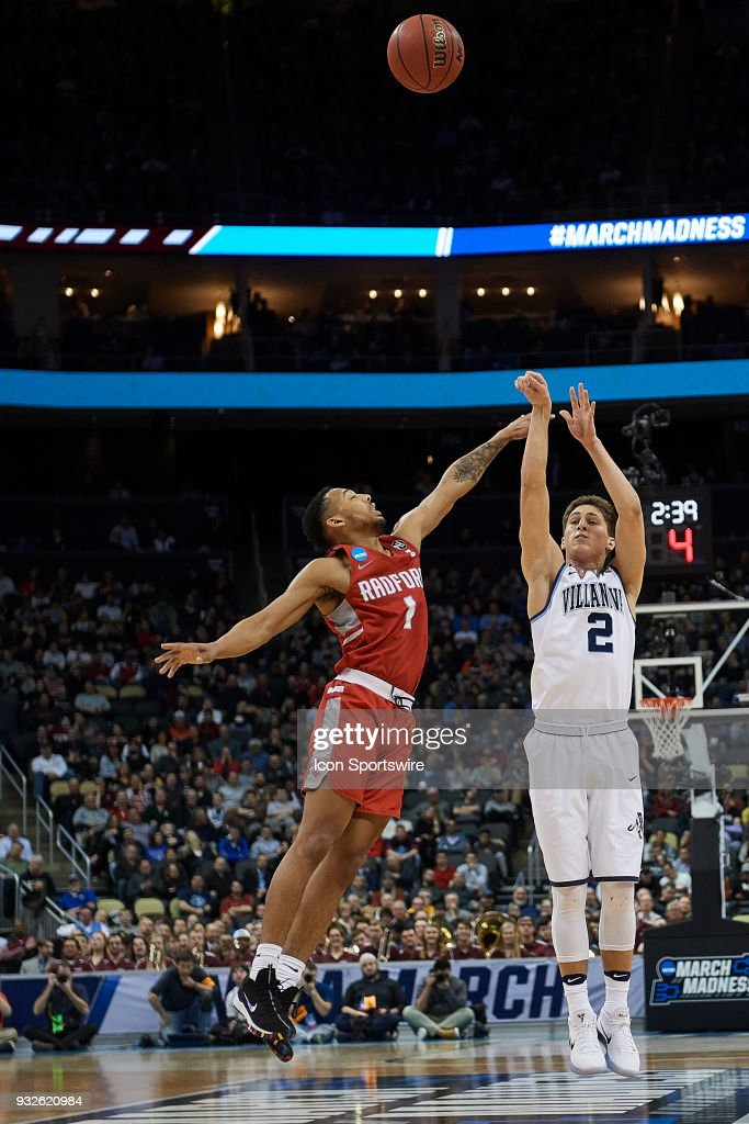 Villanova Wildcats guard Collin Gillespie (2) shoots over Radford Highlanders guard Carlik Jones (1) during the second half of the first round of the NCAA Division I Men's Championships between the Villanova Wildcats and the Radford Highlanders at PPG Paints Arena in Pittsburgh, PA on March 15, 2018.