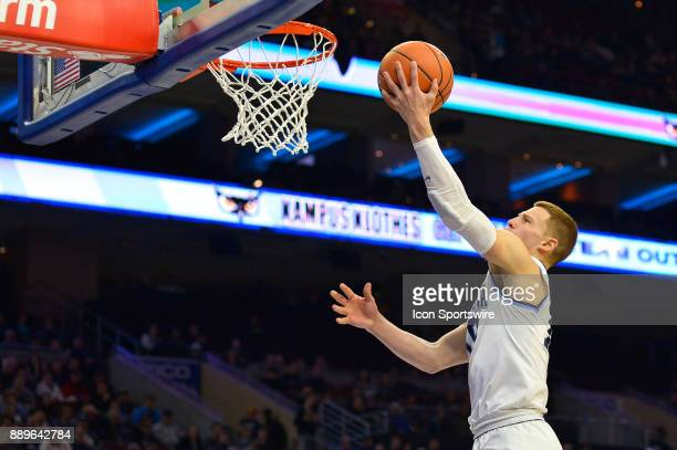 Villanova Wildcats guard Donte DiVincenzo sails through the air on the way to the basket during the college basketball game between the La Salle...