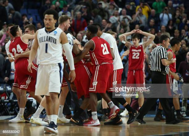 Villanova Wildcats guard Jalen Brunson walks off the court as the Wisconsin Badgers celebrate their victory during the NCAA Division 1 Men's...