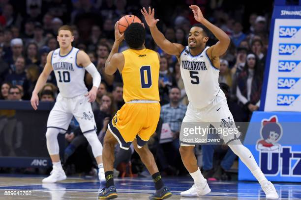 Villanova Wildcats guard Phil Booth defends against La Salle Explorers guard Pookie Powell during the college basketball game between the La Salle...