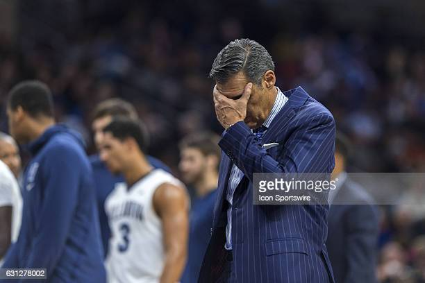 Villanova Wildcats head coach Jay Wright walks off the court dejected with his face in his hand during the game between the Marquette Golden Eagles...