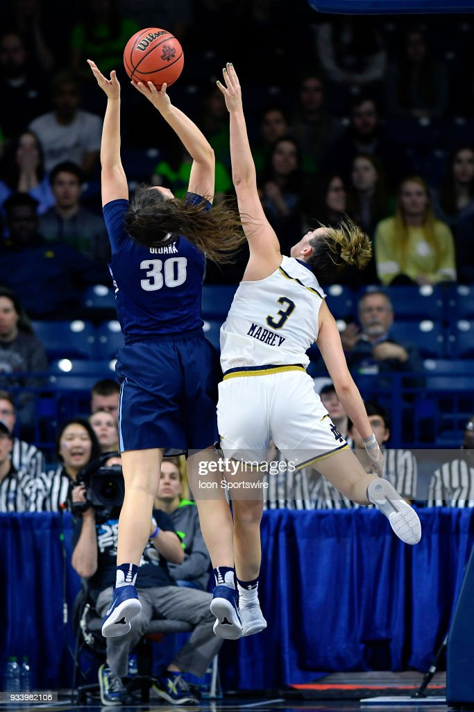 Villanova Wildcats' Mary Gedaka (30) has her shot challenged by Notre Dame Fighting Irish's Marina Mabrey (3) during the second round of the Division I Women's Championship on March 18, 2018 in South Bend, Indiana.