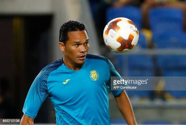 Villareal's Colombian forward Carlos Bacca warms up before the start of the UEFA Europa League Group A football match between Maccabi Tel Aviv and...