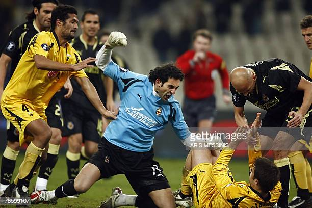 Villareal's goalie Diego Lopez tries to punch AEK's Sotiris Papastathopoulos during their UEFA cup group stage football game in Athens 20 December...