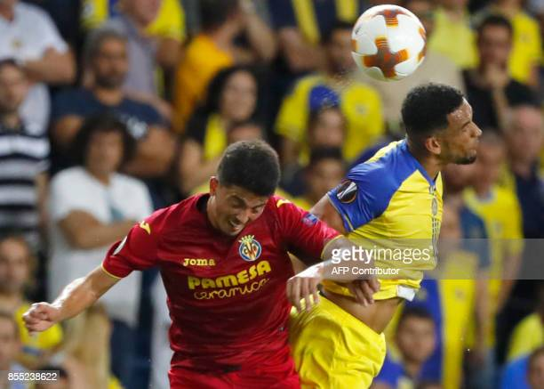 Villareal's Spanish midfielder Pablo Fornals and Maccabi's English forward Nick Blackman vie for the ball during the UEFA Europa League Group A...