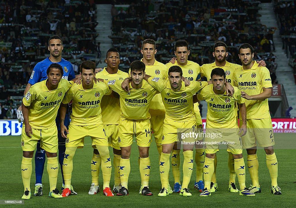 Villarreal CF line up prior to start the La Liga match between Elche CF and Villarreal CF at Estadio Manuel Martinez Valero on November 4, 2013 in Elche, Spain.