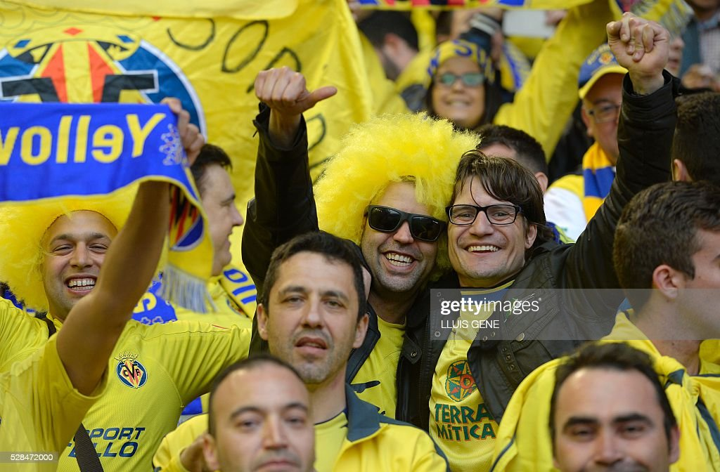 Villarreal fans are pictured before the start of the UEFA Europa League semi-final second leg football match between Liverpool and Villarreal CF at Anfield in Liverpool, northwest England on May 5, 2016. / AFP / LLUIS