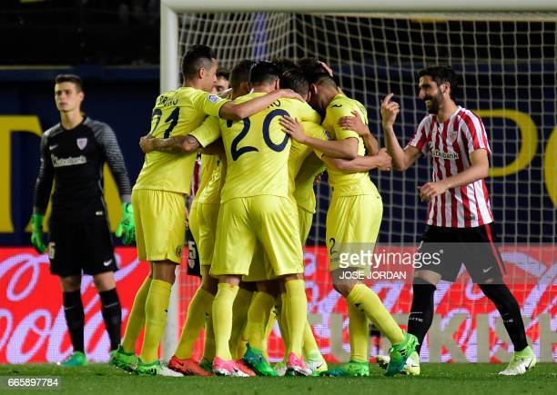 Villarreal players celebrate a goal during the Spanish league football match Villarreal CF vs Athletic Club Bilbao at El Madrigal stadium in Vilareal...