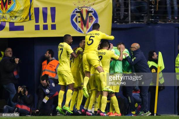 Villarreal players celebrate their first goal during the Spanish League football match Villarreal CF vs Real Madrid at El Madrigal stadium in...