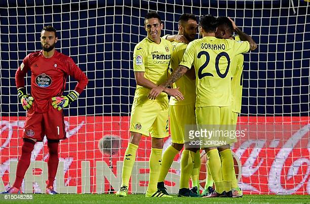 Villarreal players celebrate their fourth goal during the Spanish league football match Villarreal CF vs RC Celta de Vigo at El Madrigal stadium in...