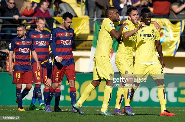 Villarreal players celebrate their second goal during the Spanish league football match Villarreal CF vs FC Barcelona at El Madrigal stadium in...