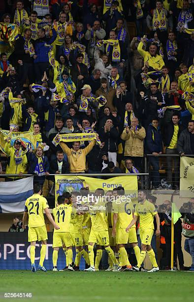 Villarreal players celebrate with fans as Adrian Lopez of Villarreal scores the first goal during the UEFA Europa League semi final first leg match...