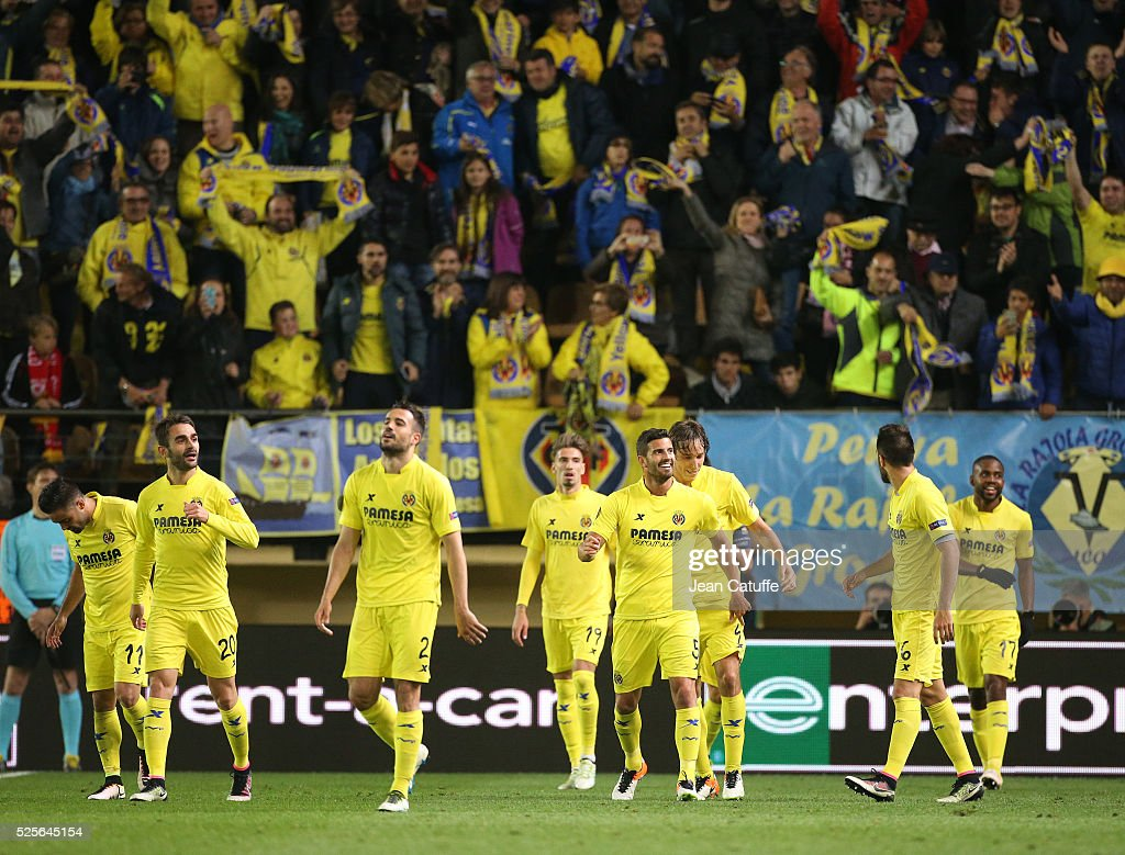 Villarreal players celebrate with fans as Adrian Lopez of Villarreal scores the first goal during the UEFA Europa League semi final first leg match between Villarreal CF and Liverpool FC at Estadio El Madrigal stadium on April 28, 2016 in Villarreal, Spain.