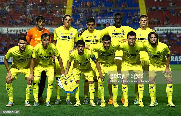 Villarreal players pose for a team picture during a Pre Season Friendly match between Levante UD and Villarreal CF at Ciutat de Valencia Stadium on...