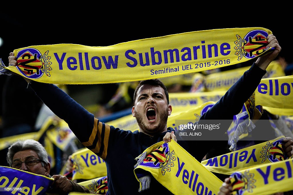 Villarreal supporters hold their team's scarves during the UEFA Europa League semifinal first leg football match Villarreal CF vs Liverpool FC at El Madrigal stadium in Vila-real on April 28, 2016. / AFP / BIEL
