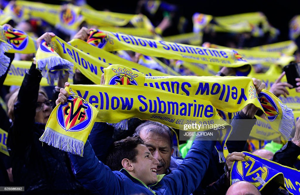Villarreal supporters hold their team's scarves during the UEFA Europa League semifinal first leg football match Villarreal CF vs Liverpool FC at El Madrigal stadium in Vila-real on April 28, 2016. / AFP / JOSE