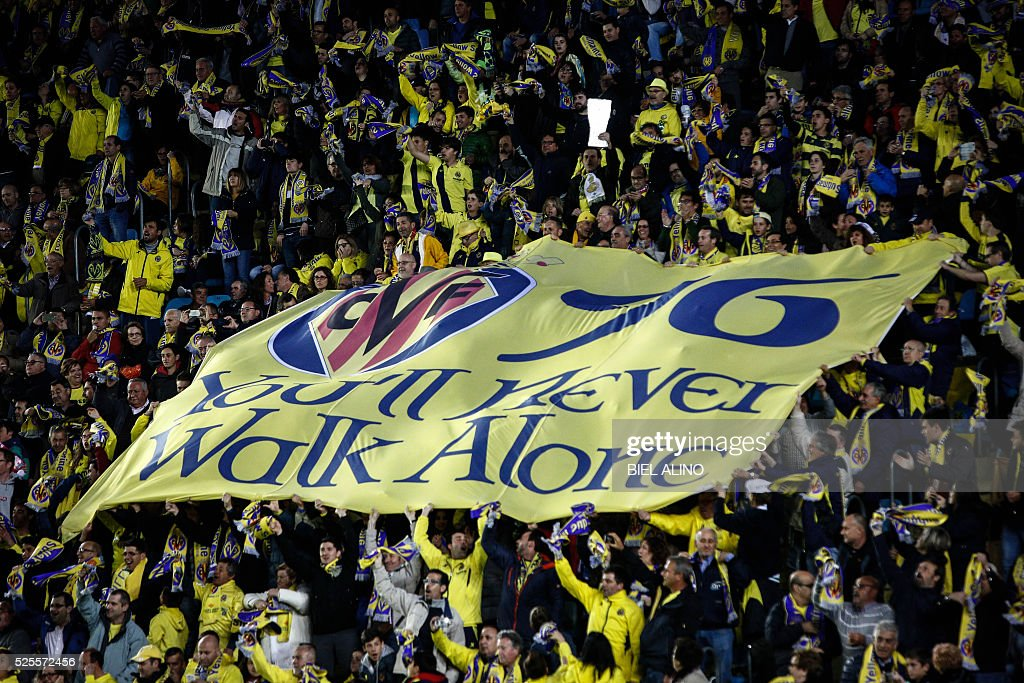 Villarreal supporters unfold a banner during the UEFA Europa League semifinal first leg football match Villarreal CF vs Liverpool FC at El Madrigal stadium in Vila-real on April 28, 2016. / AFP / BIEL