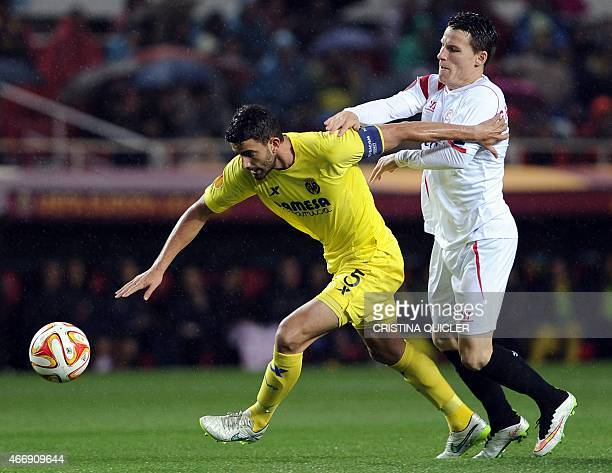 Villarreal's Argentinian defender Mateo Musacchio vies with Sevilla's French forward Kevin Gameiro during the Europa League football match FC Sevilla...