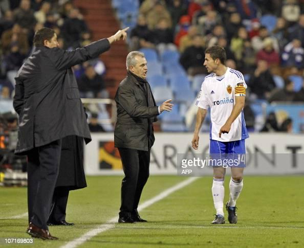 Villarreal's coach Javier Aguirre speaks with Zaragoza's midfielder Gabi Fernandez during the Spanish League football match Zaragoza vs Villareal at...