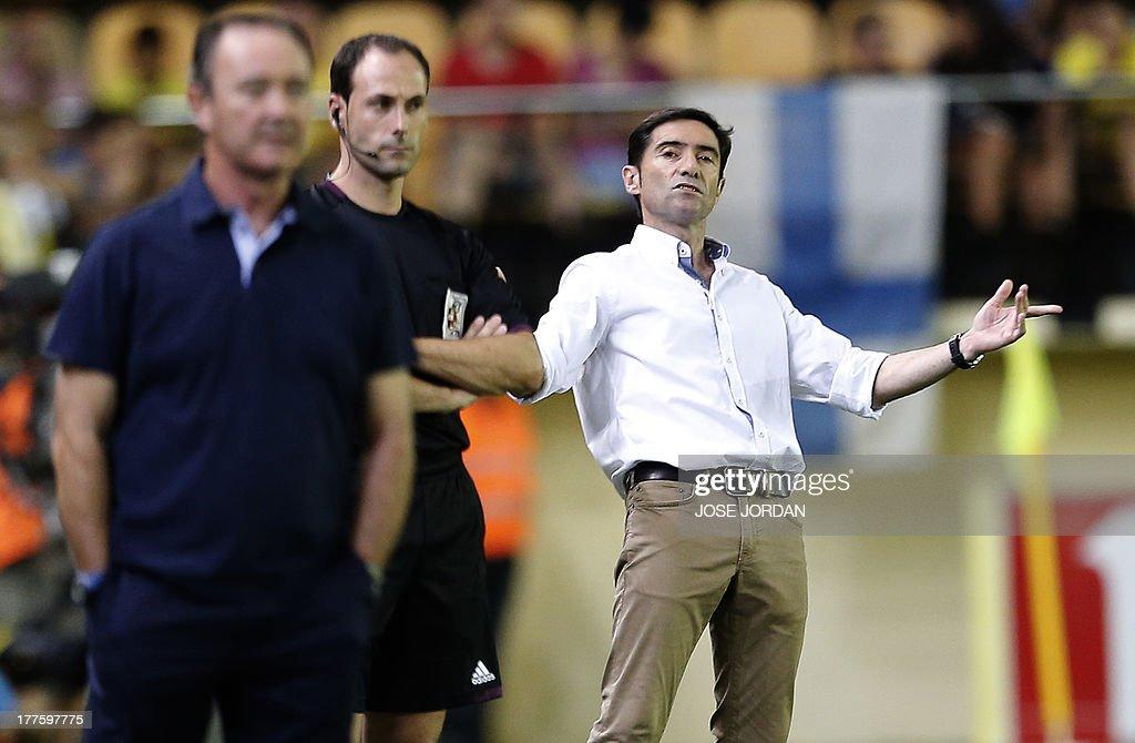 Villarreal's coach Marcelino Garcia Toral (R) gestures during the Spanish league football match Villarreal CF vs Real Valladolid FC de Madrid at El Madrigal stadium in Villareal on August 24, 2013.
