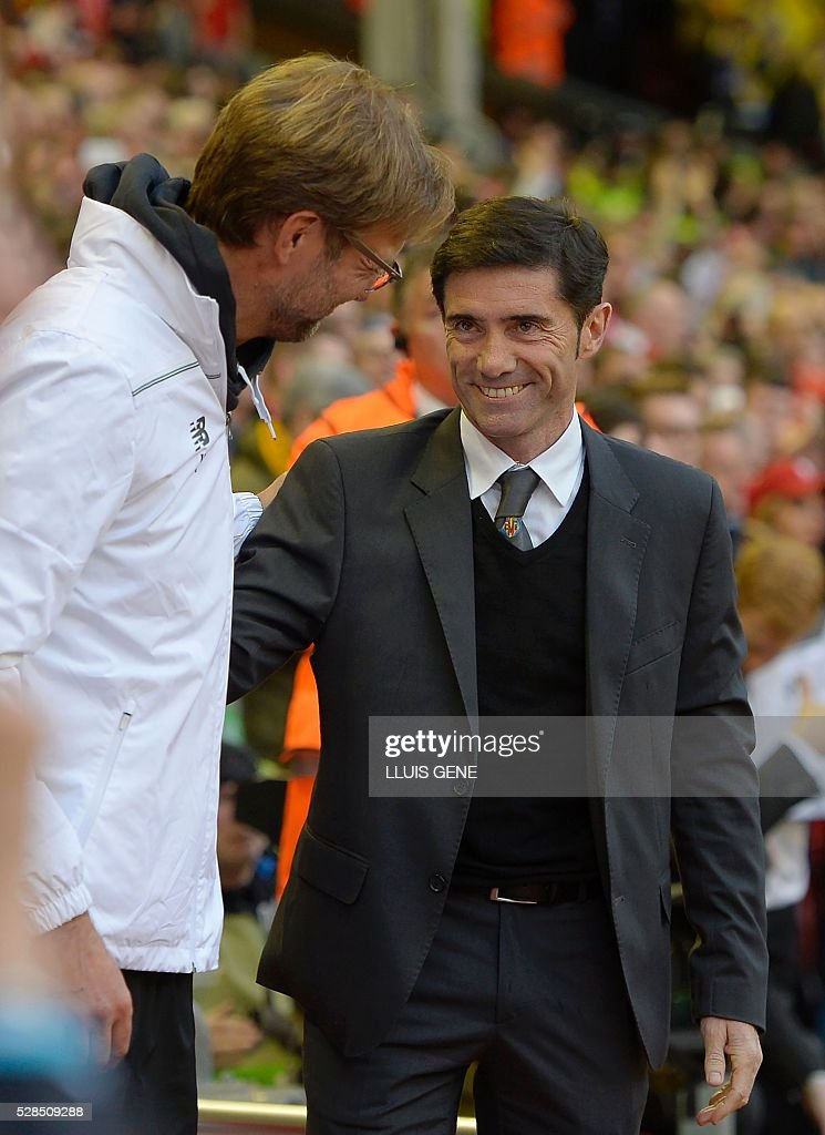Villarreal's coach Marcelino Garcia Toral (R) speaks with Liverpool's German manager Jurgen Klopp before the start of the UEFA Europa League semi-final second leg football match between Liverpool and Villarreal CF at Anfield in Liverpool, northwest England on May 5, 2016. / AFP / LLUIS