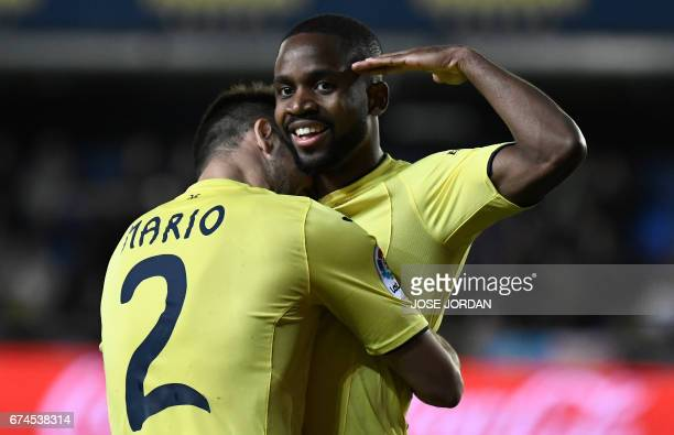 Villarreal's Congolese forward Cedric Bakambu celebrates a goal during the Spanish league football match Villarreal CF vs Real Sporting de Gijon at...