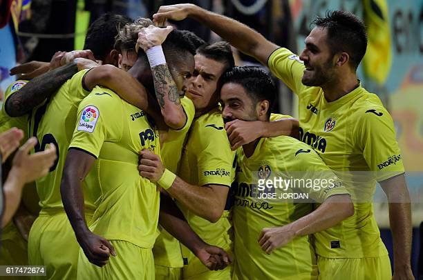 Villarreal's Congolese forward Cedric Bakambu celebrates a goal with teammates during the Spanish league football match between Villarreal CF and UD...