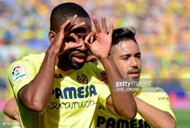 Villarreal's Congolese forward Cedric Bakambu celebrates past Villarreal's defender Jaume Costa after scoring during the Spanish league football...