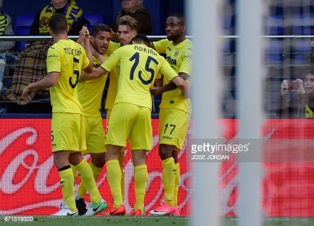 Villarreal's Congolese forward Cedric Bakambu celebrates with teammates after scoring during the Spanish league football match Villarreal CF vs Club...